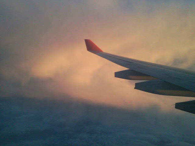 Wing of the ship, over the clouds